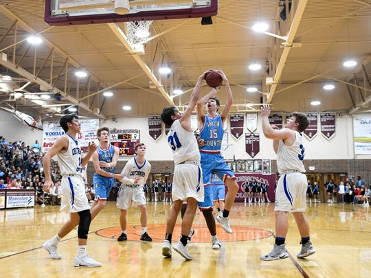 Union County's Elex Dunford (15) shot is blocked by Crittenden County's Preston Turley (31) as the Union County Braves play the Crittenden County Rockets in the Second Region Tournament at Henderson's Colonel Gym Thursday, March 1, 2018.