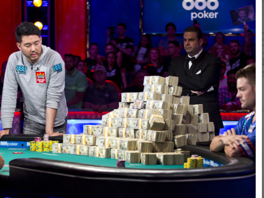 John Cynn, left, took his time before calling the last hand of the WSOP Main Event, which made him $8.8 million.
