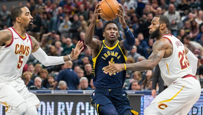 Jan 12, 2018; Indianapolis, IN, USA; Indiana Pacers guard Victor Oladipo (4) shoots the ball while Cleveland Cavaliers guard JR Smith (5) and forward LeBron James (23) defend in the second half at Bankers Life Fieldhouse. Mandatory Credit: Trevor Ruszkowski-USA TODAY Sports