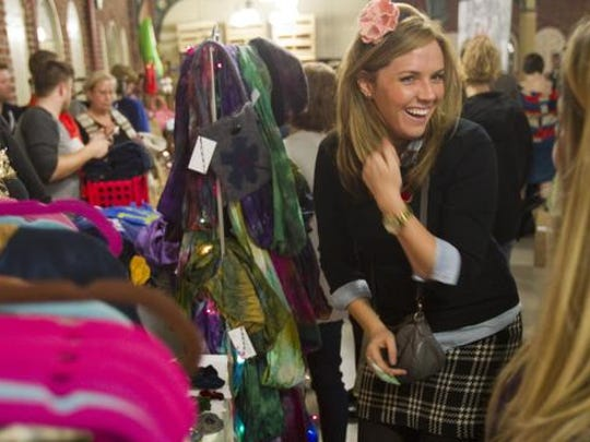 Hadley Green, Indianapolis, models a hair band for a friend that's on sale at Yelp's Totally Bazaar holiday shopping event