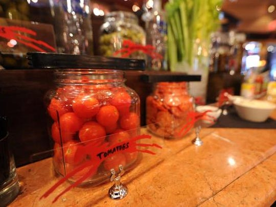 Tomatoes are available as a topping at the build your own Bloody Mary station, Sunday, December 15, 2013, at Palomino Restaurant & Bar.
