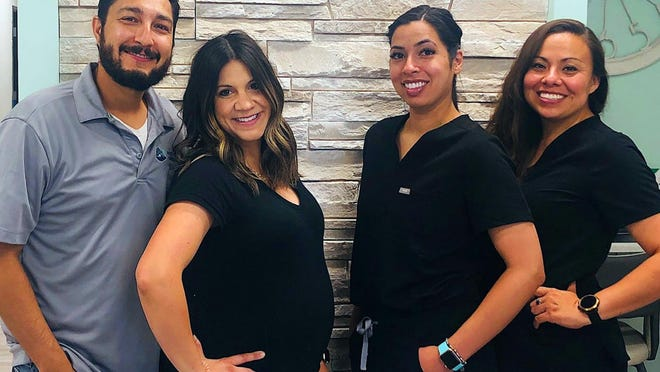 Dr. David Sisneros and his team (from left) Alyssa Sisneros, dental hygeienist; Nura Noriega, dental assistant; and Janelle Marquez, office manager, recently reopened the Rocky Mountain Dental Company in Pueblo.