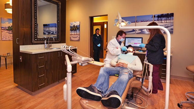 Dr. Thomas Ringenberg works on walk-in patient Shane Lee, 24, Indianapolis, at 24 Hour Dental Care, a round-the-clock clinic that Midwest Oral Health dentists opened in December at 435 Virginia Ave. Ringenberg, who staffs the clinic after 5 p.m., typically sees 12 to 14 overnight patients.