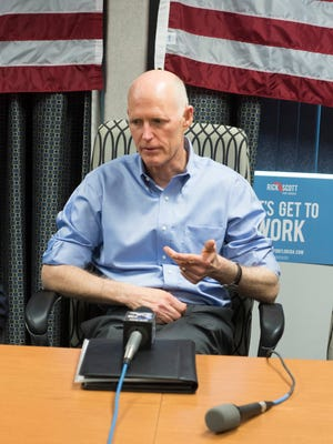 Gov. Rick Scott speaks with a group of small business owners at Pete Moore Chevrolet during a campaign stop in Pensacola, Tuesday, April 24, 2018. Scott is running for the U.S. Senator, against the incumbent Sen. Bill Nelson.