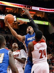Hofstra's Zeke Upshaw, rear, attempts a shot over the defense of Louisville's Montrezl Harrell during the first half of an NCAA college basketball game Tuesday, Nov. 12, 2013, in Louisville, Ky.
