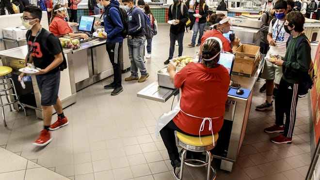 Garden City High School students make their way through the cafeteria lines during a lunch period earlier this school year.