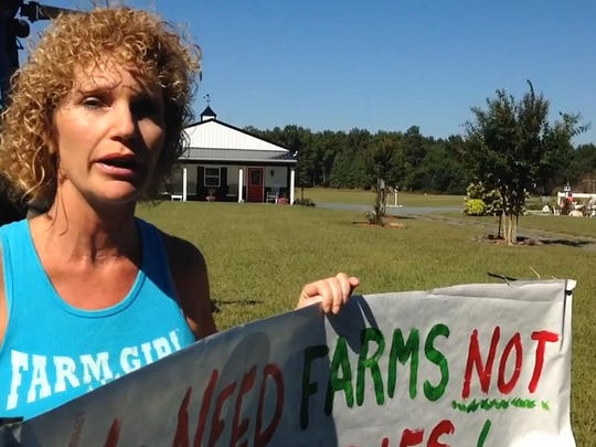 Lisa Inzerillo opposes proposed multi-structure poultry farms near her home in the Backbone Road area of Somerset County, Md.