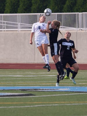 Maddie Fouts of Gull Lake goes up for a header during a Division 2 state semifinal against DeWitt.