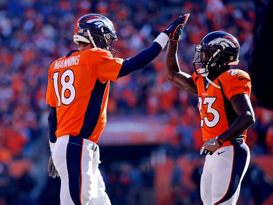 Denver Broncos quarterback Peyton Manning celebrates with running back Ronnie Hillman during the AFC Championship game against New England.