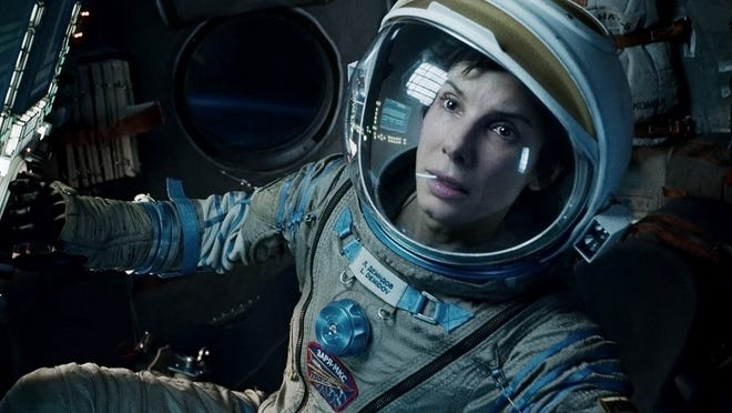 "This film image released by Warner Bros. Pictures shows Sandra Bullock in a scene from ""Gravity."" This year's best picture race at the 86th Academy Awards on Sunday, March 2, 2014, has shaped up to be one of the most unpredictable in years. The favorites are ""12 Years a Slave,"" ""Gravity"" and ""American Hustle.""  (AP Photo/Warner Bros. Pictures, File) ORG XMIT: CAET657"