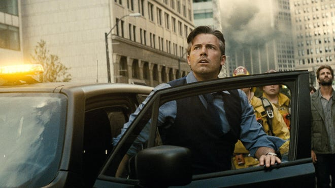 Bruce Wayne (Ben Affleck) exits his vehicle during an attack on Metropolis filmed on Fort in downtown Detroit.