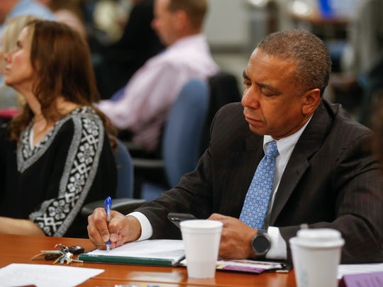 Assistant U.S. Attorney Abram McGull takes down notes