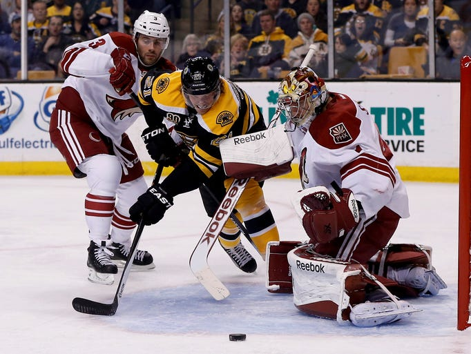 March 13, 2014 -  Boston Bruins right wing Loui Eriksson (21) is defended by Phoenix Coyotes defenseman Keith Yandle (3) with goalie Mike Smith (41) in the net during the first period at TD Banknorth Garden.