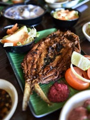 Fried bangus with side salad is one of many freshly prepared choices at Nayon Express in Harmon, on Feb. 9