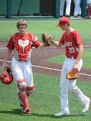 Albany catcher Adam Faith congratulates pitcher Ryan