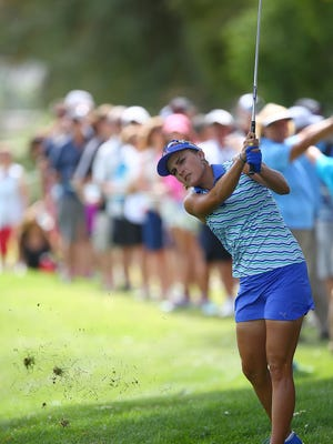 Lexi Thompson hits out of the rough on the fourth hole of the ANA Inspiration in Rancho Mirage, April 3, 2016.