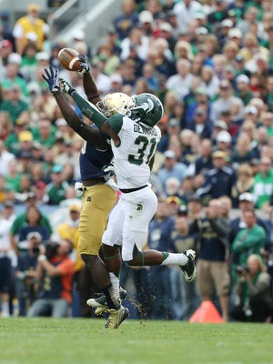 Michigan State Spartans cornerback Darqueze Dennard (31) breaks up a pass intended for Notre Dame Fighting Irish wide receiver DaVaris Daniels (10) at Notre Dame Stadium.