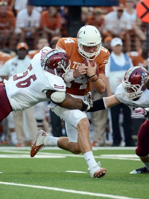 Texas quarterback David Ash, seen here in a game against New Mexico State, will miss Texas' game against No. 25 Ole Miss due to injuries he sustained against BYU.