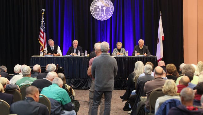 The Palm Springs City Council meets at the Palm Springs Convention Center on Feb. 27 to hear from residents in the wake of bribery, perjury and conflict of interest charges filed against former Mayor Steve Pougnet and developers John Wessman and Richard Meaney.