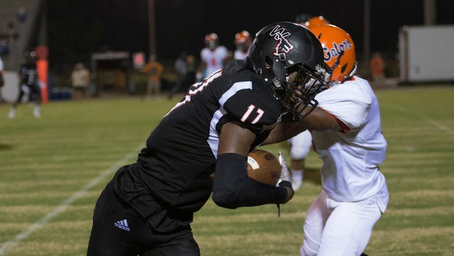 Ko Burrell (17) barrels his way along the sidelines as he heads to the endzone for a touchdown during the Escambia vs West Florida high school football game in Pensacola on Thursday, August 24, 2017.