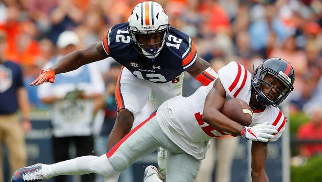 Cocoa grad Jamel Dean (12) of the Auburn Tigers defends a pass attempt to Ole Miss' Van Jefferson at Jordan Hare Stadium on October 7, 2017.  (Photo by Kevin C. Cox/Getty Images)