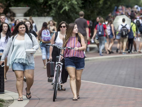 Students travel along McKinley Avenue on Tuesday afternoon