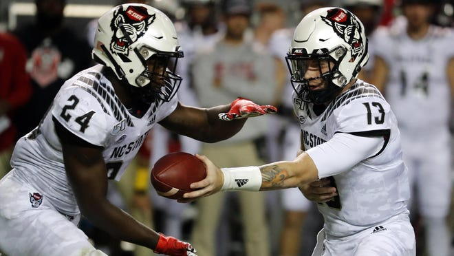 Running back Zonovan Knight, left, and quarterback Devin Leary, right, will wait an extra week for N.C. State's first game of the football season.