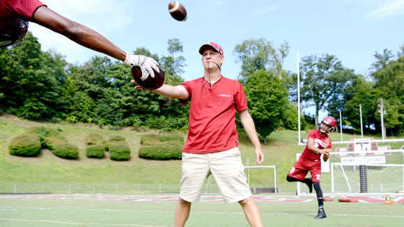 Devon Davidson throws a pass on the first day of official football practice for Asheville High on Aug. 1.