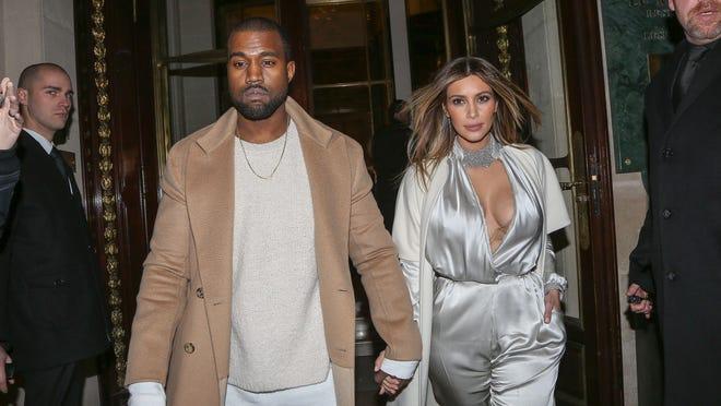 Kanye West and Kim Kardashian on Jan. 21, 2014 in Paris.