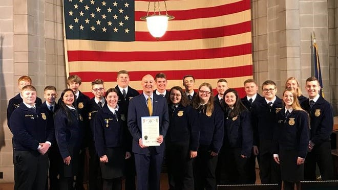 Gov. Pete Ricketts and members of the Nebraska FFA Association celebrate FFA week at the State Capitol.