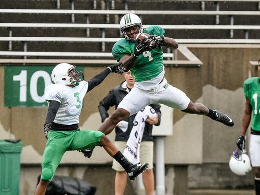 Marshall wide receiver Deon-Tay McManus (4) catches