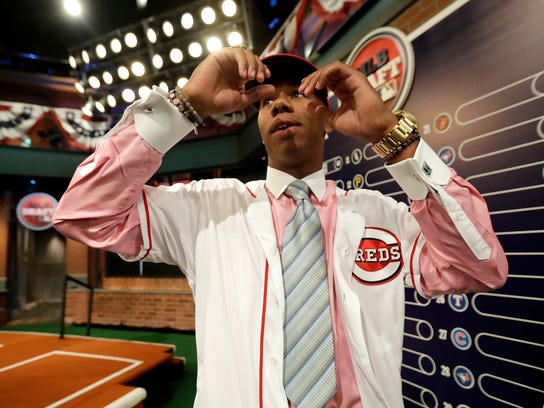Hunter Greene, a pitcher and shortstop from Notre Dame High School in Sherman Oaks, Calif., walks off the stage after being selected No. 2 by the Cincinnati Reds in the first round of the Major League Baseball draft, Monday, June 12, 2017, in Secaucus, N.J. (AP Photo/Julio Cortez)