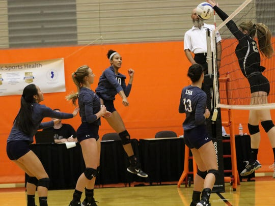 Although they were on opposite sides of the net in the 2017 NJSIAA girls volleyball Tournament of Champions final, IHA's Sydney Taylor (10) and River Dell's Makayla Serrett (blocking) are AAU club teammates this summer.