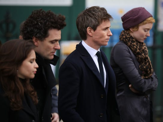 Actor Eddie Redmayne leaves Great St Mary's Church