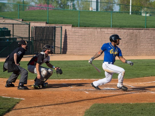 Chris Grayson (3) bats during an exhibition game on