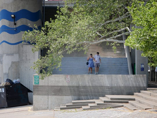 A couple walks the steps near the Public Landing, an area that stays pretty well maintained.