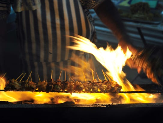 Chicken satay is said to be a popular street vendor