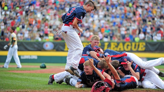 Mid-Atlantic Region players celebrate after beating the Asia-Pacific Region 2-1 during the championship game of the 2016 Little League World Series at Howard J. Lamade Stadium on Aug. 28, 2016.
