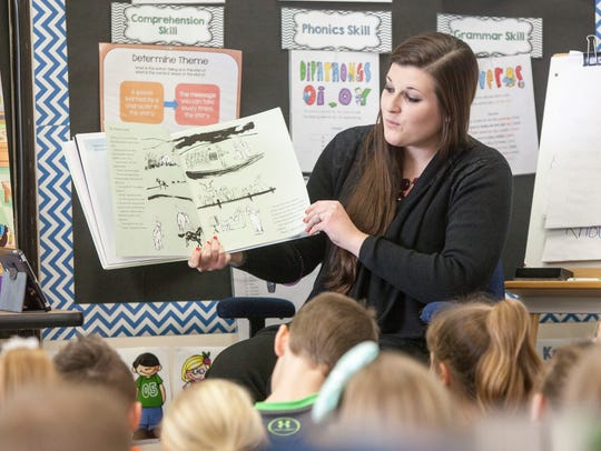 Carissa Holloway reads to her second grade class at