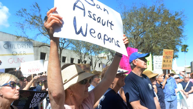 Eileen Forster, of Sebastian, joins about 150 people on the steps of the Indian River County Courthouse on Wednesday, Feb. 21, 2018 in a rally for stricter gun laws.