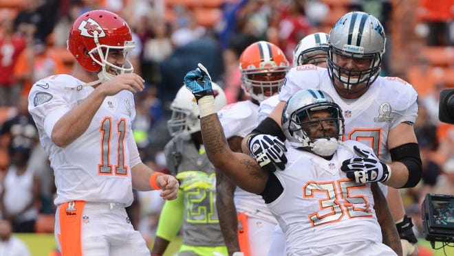 Team Rice fullback Mike Tolbert of the Carolina Panthers (35) celebrates after scoring the game-winning two-point conversion during the fourth quarter of the 2014 Pro Bowl against Team Sanders at Aloha Stadium.