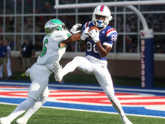 Louisiana Tech wide receiver Rashid Bonnette (86) receives the ball as North Texas safety Kishawn McClain (6) attempts to block him during a game at Joe Aillet Stadium in Ruston, La., Saturday, Nov. 4, 2017.