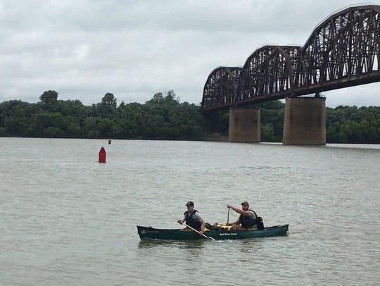 Tyler Brezina, front, and Jackson Gray, back, paddle