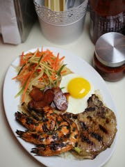 Crispy rice with grilled pork chop, Chinese sausage,