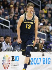 Moe Wagner celebrates during U-M's 84-77 win over Minnesota in the Big Ten tournament semifinal March 11, 2017 in Washington.