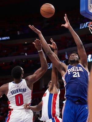 Philadelphia 76ers center Joel Embiid (21) goes for the rebound against Detroit Pistons center Andre Drummond (0) in the second half at Little Caesars Arena.