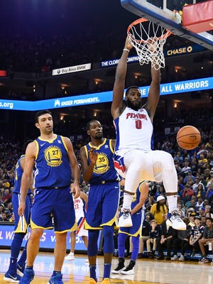 Pistons center Andre Drummond (0) dunks the basketball against Warriors center Zaza Pachulia (27) and forward Kevin Durant (35) during the second quarter on Sunday, Oct. 29, 2017, in Oakland, Calif.