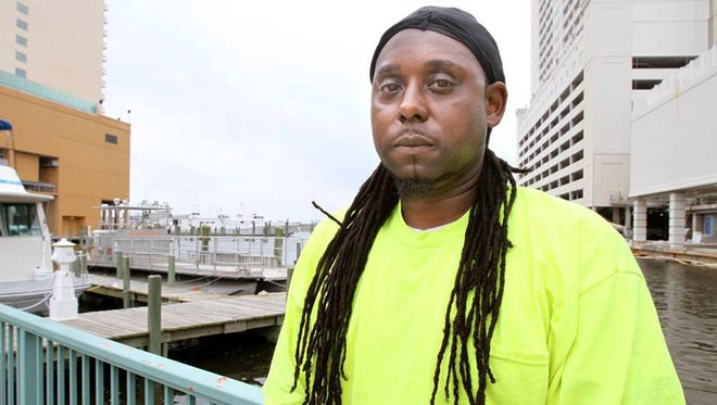 Larry Christmas Jr. is suing the city of Gulfport because he was told he couldn't be a firefighter unless he cut his dreadlocks.