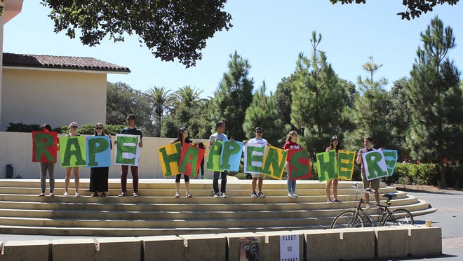 Students hold up a sign about rape at White Plaza during New Student Orientation on the Stanford campus in 2015.