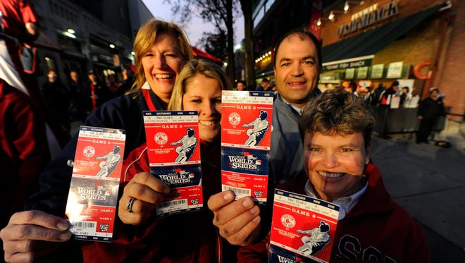 Red Sox fans from left Doreen Wrick , Liz Arangio , Rich Paglia and Nancy Culliford pose with their tickets before Game 6.